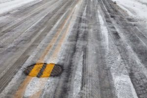 slippery icy road with yellow line
